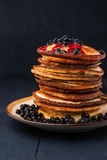 Pancakes with blueberry jam and berries  on the  wooden table Stock Photos