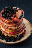 Pancakes with blueberry jam and berries  on the  wooden table top view Royalty Free Stock Photo