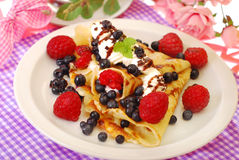 Pancakes with blueberry and raspberry. Pancake with fresh blueberry,raspberry fruits and whipped cream poured chocolate sauce Stock Photos