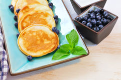 Pancakes with blueberry in rectangular plate on the wooden table Stock Image