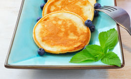 Pancakes with blueberry in rectangular plate on the wooden table Royalty Free Stock Photos