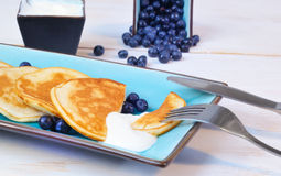 Pancakes with blueberry in rectangular plate on the wooden table Stock Photo