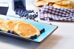 Pancakes with blueberry in rectangular plate on the wooden table Stock Images