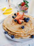 Pancakes with blueberry and strawberry Royalty Free Stock Image
