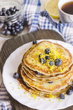 Pancakes with blueberry on white plate. Stock Images