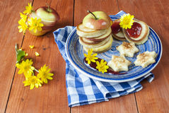 Pancakes for breakfast. Pancakes with jam and apple for breakfast, pastries and sweets,cooking dessert Royalty Free Stock Images