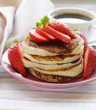 Pancakes for breakfast with strawberries Royalty Free Stock Photos