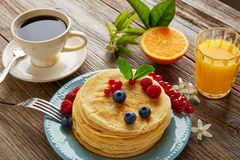 Pancakes breakfast syrup coffe and orange juice Stock Image