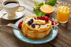 Pancakes breakfast syrup coffe and orange juice Stock Photo