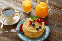 Pancakes breakfast syrup coffe and orange juice Royalty Free Stock Photo