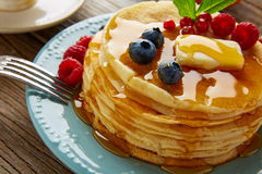 Pancakes breakfast syrup coffe and orange juice Stock Photos