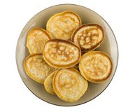 Pancakes in brown plate isolated on white background Stock Photos