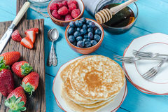 Pancakes for brunch with berry fruits Stock Images