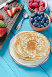 Pancakes for brunch with berry fruits Royalty Free Stock Photo