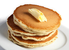 Pancakes and butter Stock Photography
