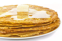 Pancakes. With butter and honey royalty free stock photography