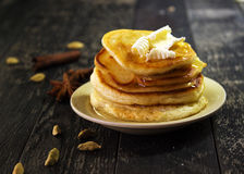 Pancakes with butter and honey on a black background Royalty Free Stock Image
