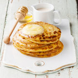 Pancakes with butter and honey Royalty Free Stock Photo