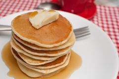 Pancakes With Butter and Maple Syrup Stock Photos