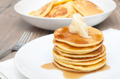 Pancakes With Butter and Maple Syrup Royalty Free Stock Images