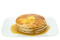 Pancakes with butter and maple syrup Royalty Free Stock Photos