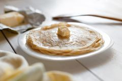 Pancakes with butter on a plate Royalty Free Stock Photography