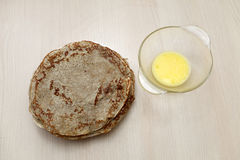 Pancakes with butter Stock Photos