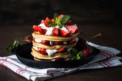 Pancakes cake with mascarpone and strawberries. Royalty Free Stock Images