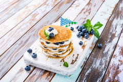 Pancakes cake with yogurt and blueberries Royalty Free Stock Photography