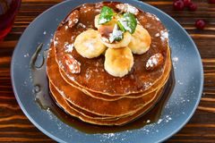 Pancakes with caramel, banana and nuts decorated with cranberrie Stock Photography