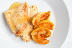 Pancakes with caramelized apple slices and honey Stock Photo