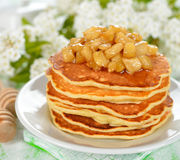 Pancakes with caramelized apples Royalty Free Stock Photos