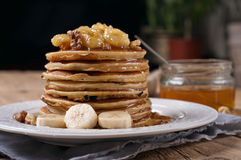 Pancakes with caramelized banana, nuts and honey Royalty Free Stock Photography