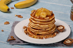 Pancakes with caramelized banana, nuts and honey Royalty Free Stock Photo