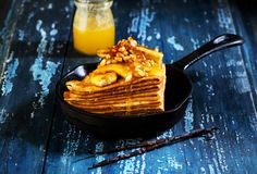 Pancakes with caramelized bananas and nuts Royalty Free Stock Photography