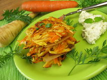 Pancakes with carrots and parsnips. And fresh vegetables Stock Photos