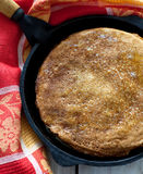 Pancakes in cast-iron pan Stock Photography