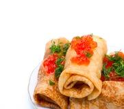 Pancakes with caviar Stock Images