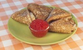 Pancakes and caviar Stock Photo
