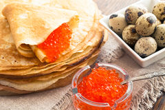 Pancakes with caviar and quail eggs Stock Photo
