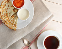 Pancakes with caviar and sour cream on a saucer Royalty Free Stock Images