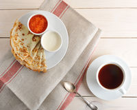 Pancakes with caviar and sour cream on a saucer Royalty Free Stock Photos