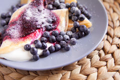 Pancakes with cheese, cream and blueberries