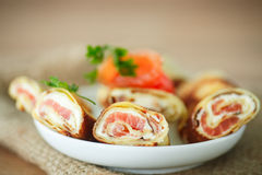 Pancakes with cheese curds and salted salmon Royalty Free Stock Images
