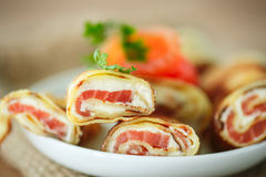 Pancakes with cheese curds and salted salmon Royalty Free Stock Image