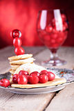 Pancakes with cherries Royalty Free Stock Photos