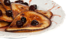 Pancakes with Cherries. Pancakes with cherry jam on white background Stock Images