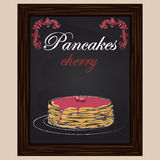 Pancakes with cherries and jam on a plate Stock Images