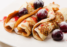 Pancakes with cherries Royalty Free Stock Photo