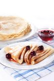 Pancakes with cherry jam Stock Images